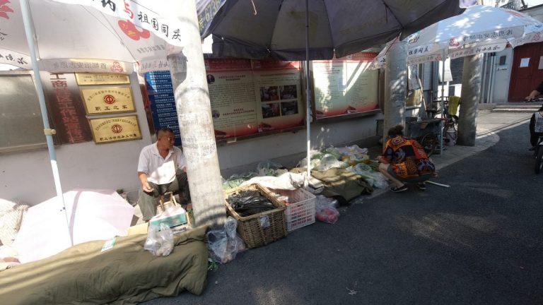Čínské fintech akcie reagují na zavedení národní digitální měny