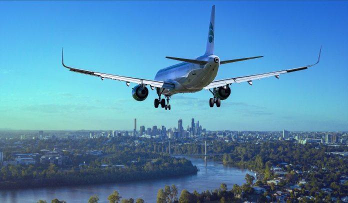město, řeka, letadlo